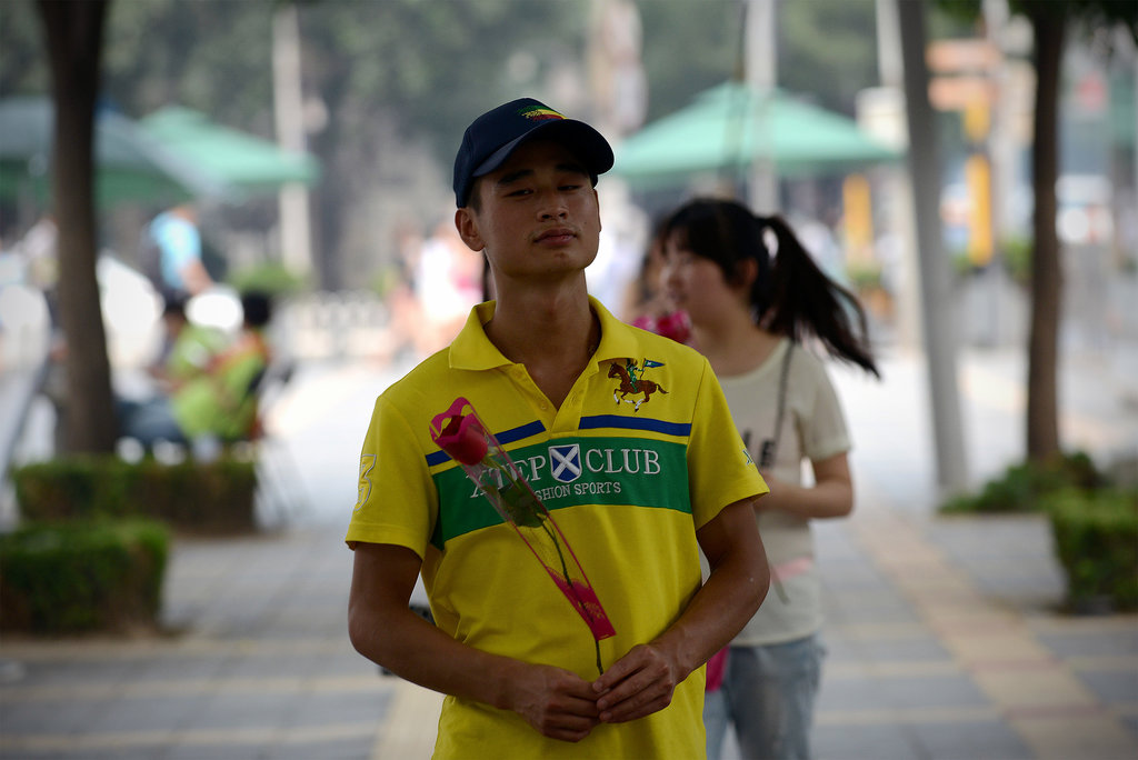 One man carried a flower through the streets of Beijing.