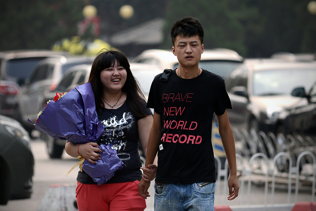 A couple walked hand in hand through the streets of Beijing.