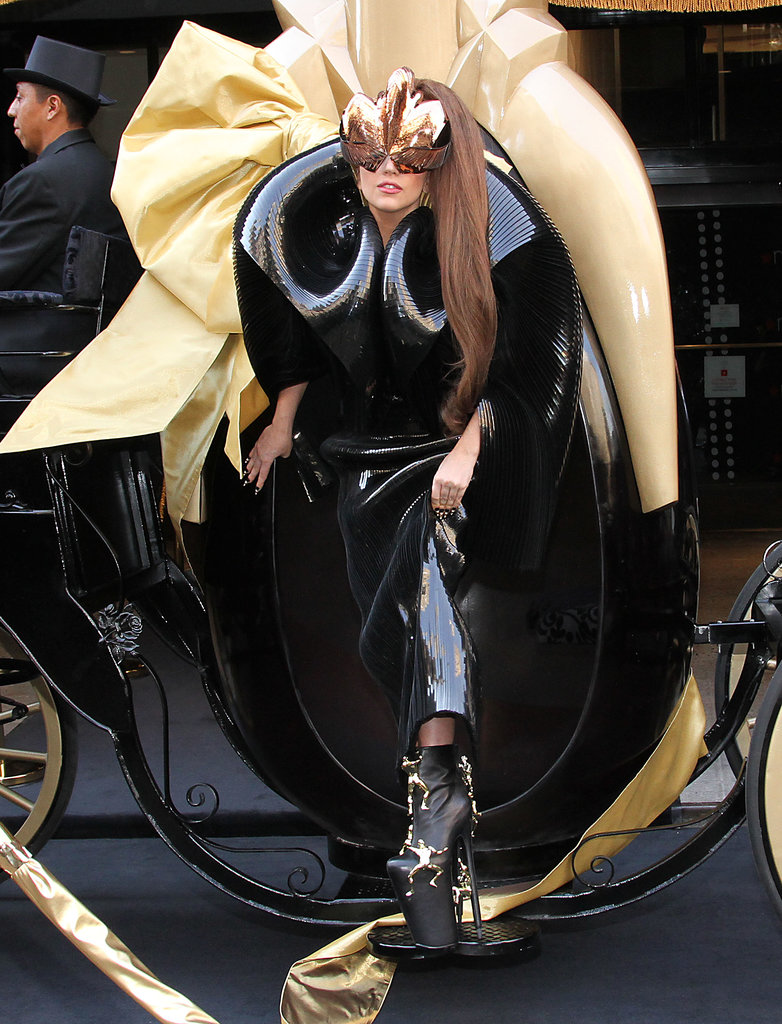 To celebrate the launch of Fame, her first scent, Lady Gaga emerged from a carriage in the shape of the black-and-gold bottle in a futuristic black evening dress with embellished platform ankle boots.