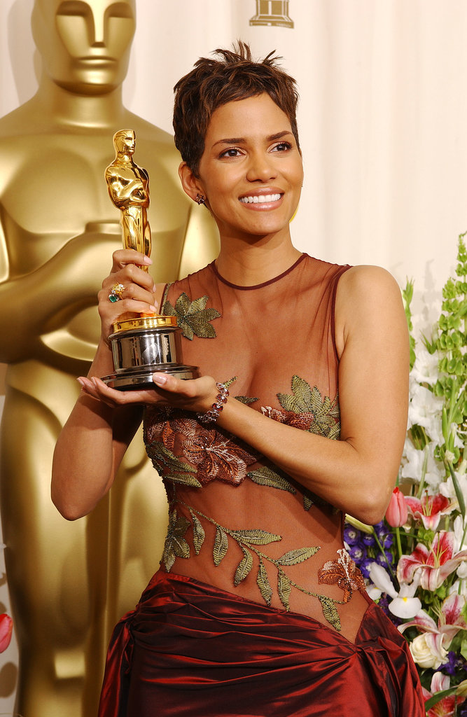 In 2002, Halle became the first black woman to win best actress for her role in Monster's Ball. Clad in an Elie Saab gown, Halle wore bronzed makeup that perfectly coordinated with her newly won statue.