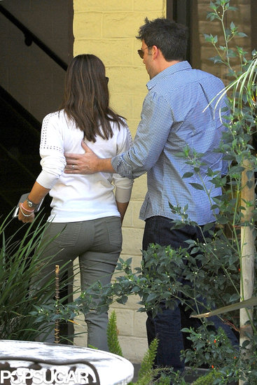 Ben Affleck placed his hand on his wife Jennifer Garner's back as they had a couple's outing in LA in July 2013.