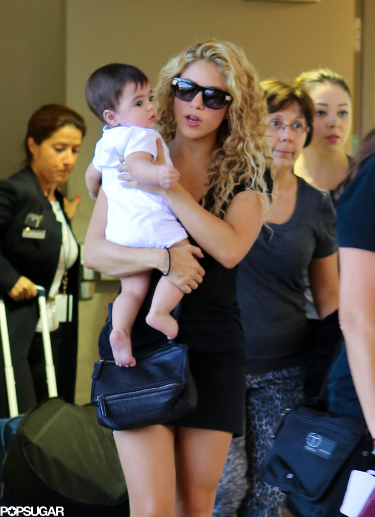 Shakira held on to her little one, Milan, while walking through the airport.