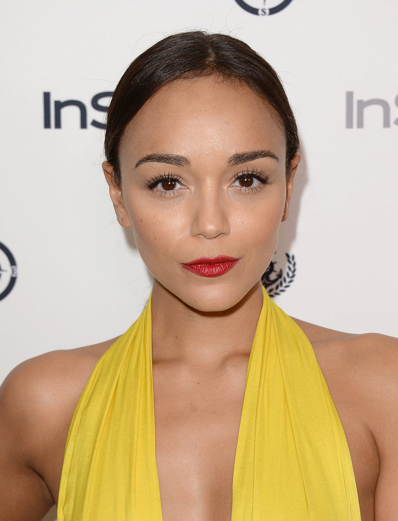 Opting for the ultimate classic beauty look, Ashley Madekwe paired a slicked-back style with bold brows and an equally bold lip.