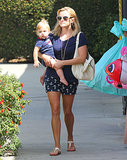Reese Witherspoon and Tennessee Toth wore matching navy blue outfits during a day at the toy store.