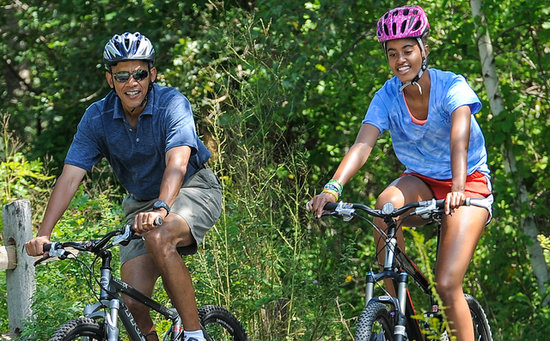 President Obama and his daughter Malia were all smiles while biking during the family's trip to Martha's Vineyard.