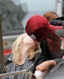 Andrew Garfield, who was sporting his Spider-Man costume, gave Emma Stone a kiss during a break from filming in NYC in May 2013.