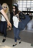 Kristen Stewart laid low in sunglasses and a baseball hat at LAX.