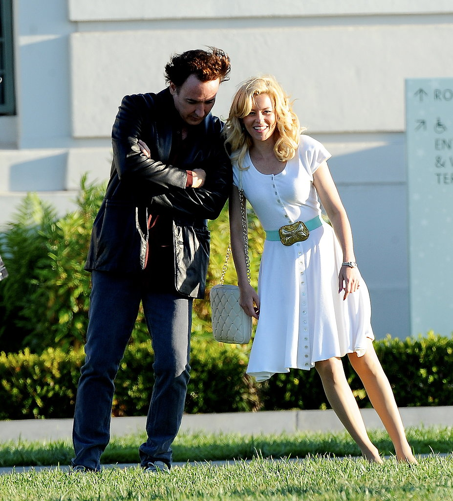 Elizabeth Banks and John Cusack joked around on the LA set of Love and Mercy on Monday.