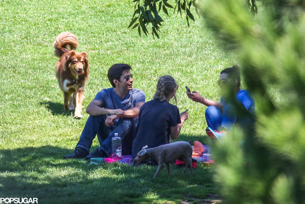 Amanda Seyfried and Justin Long conversed with their friends in the shade.
