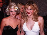 Courtney Love and a young Drew Barrymore hooked up for a photo op at the 1995 VMAs. Both women wore dark red lipstick, but Drew accented her hair with a few daisies, bringing a new meaning to flower child.