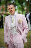 Proving men have serious style, too, this dapper gent paired a pale pink suit with a straw topper, flower, and well-groomed mustache.  Photo: Jane Kratochvil