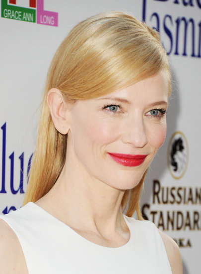 At the premiere of her film Blue Jasmine, Cate Blanchett stunned with a sleek, deep side part and bold red lip. The look only enhanced her flawless complexion.