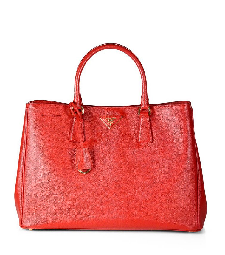 Make a polished statement in this classic red Prada Safffiano tote ($1,870).