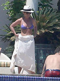 Jennifer Aniston wrapped a towel around her torso.