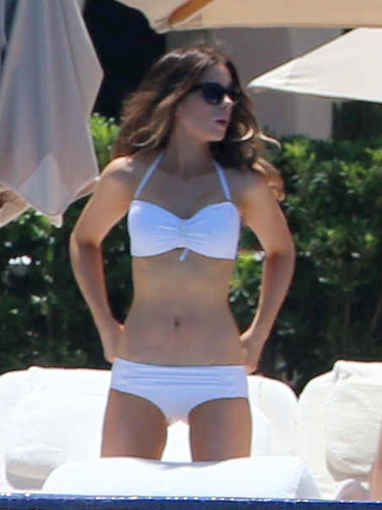 Kate Beckinsale showed off her fit frame in a white bikini during a trip to Cabo in August.