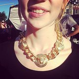 MTV zoomed in on Grimes's golden Versace necklace. Source: Instagram user mtvstyle