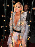 Rita Ora sported a big grin when she arrived at the VMAs.