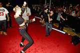 Miley Cyrus danced for fans on the VMAs red carpet.