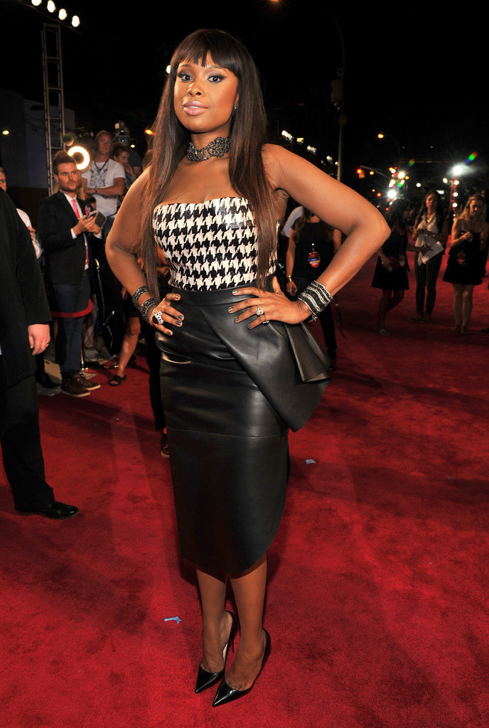 Jennifer Hudson tucked a black-and-white houndstooth bustier into a black leather pencil skirt, then added pointy pumps for a classic edge. She kept the black-and-white motif going with stacked bracelets and a necklace by Lorraine Schwartz.