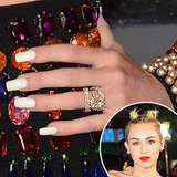 Miley Cyrus added a pop of contrast to her bejeweled black ensemble with solid white nails.