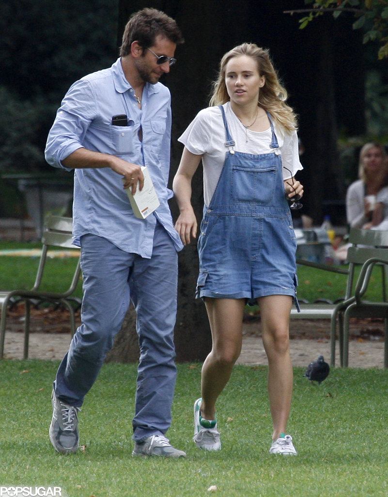Bradley Cooper walked hand in hand through a Paris park with his girlfriend Suki Waterhouse.