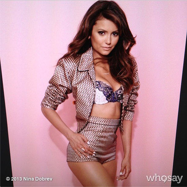 Nina Dobrev shared a behind-the-scenes moment from her lingerie-inspired Cosmopolitan shoot. Source: Instagram user ninadobrev