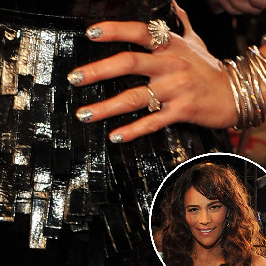 Paula Patton's husband Robin Thicke made headlines with his provocative performance with Miley Cyrus, but she looked just as stunning in a shimmering black gown with metallic nail art.