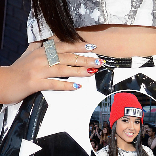 Rapper and CoverGirl spokesperson Becky G showed off her bold style straight down to her graphic nail art.