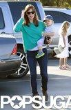 Jennifer Garner carried little Samuel on a trip to a farmers market in LA.