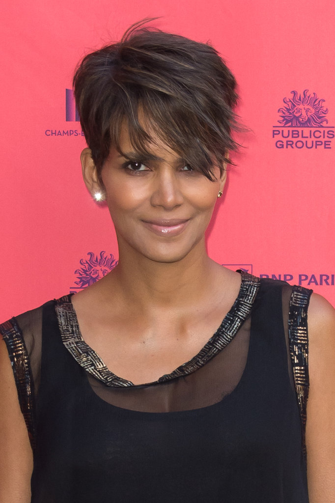 To give her iconic haircut dimension, Halle Berry weaves a hint of honey blond throughout her walnut-toned strands.