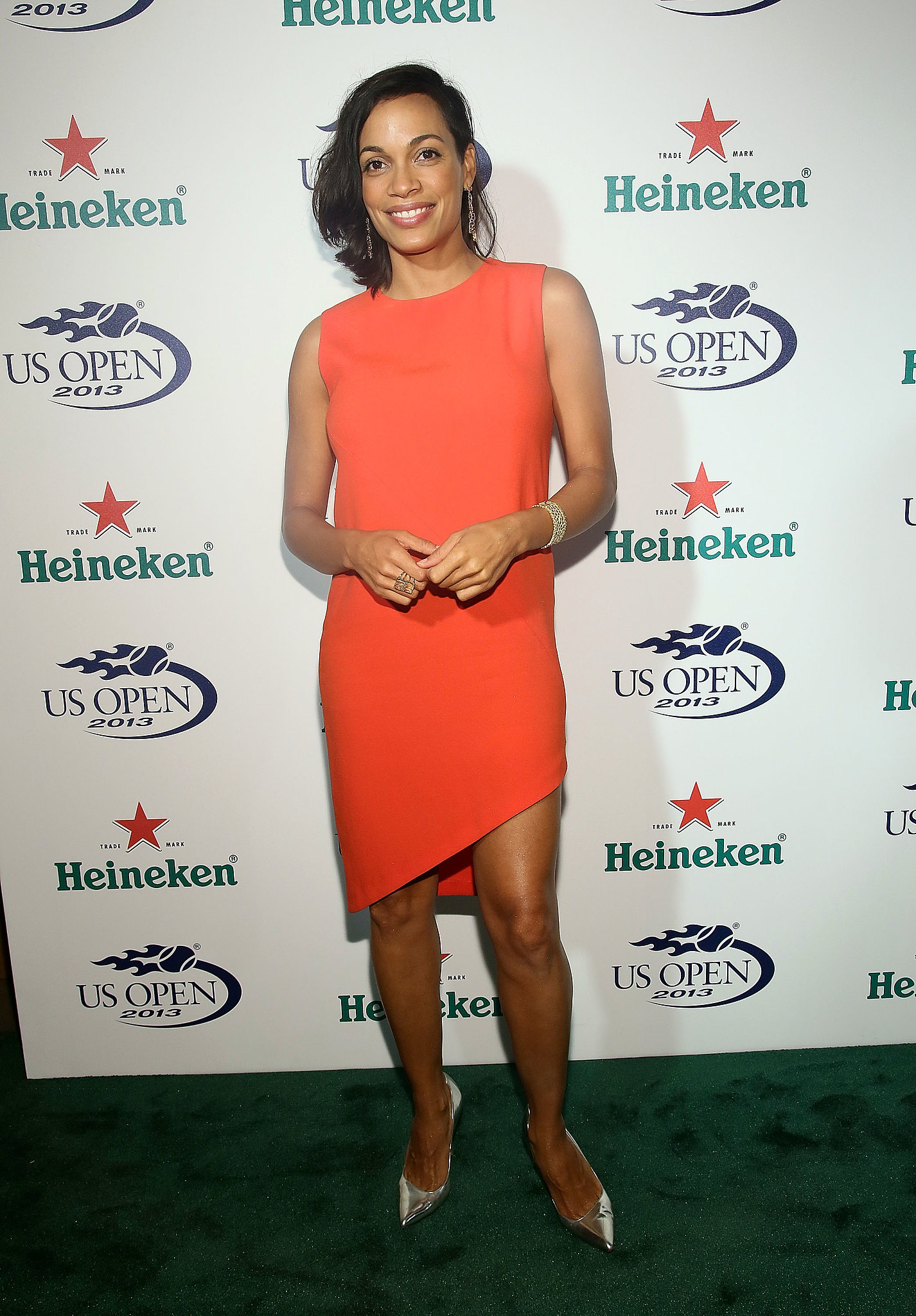 Rosario Dawson got fresh with an orange dress and silver metallic pumps at the 2013 US Open Kick-Off party in NYC.