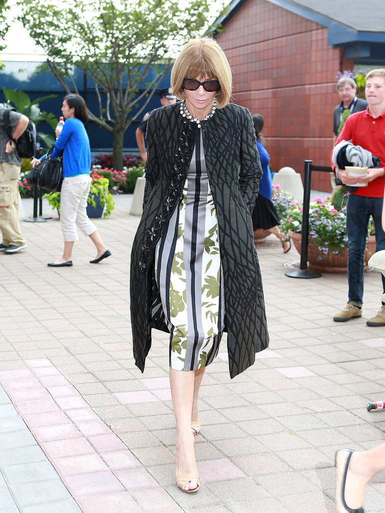 Anna Wintour made her way to the 13th Annual USTA Serves opening night gala in NYC wearing her signature sophisticated style: a printed dress with a statement coat.