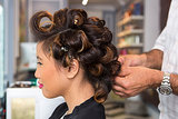 Continue curling your entire head and secure each section with duck bill clips to hold your pin curls. They should all be curling down, and the hair on top of your head should be curled away from your face.