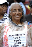 One woman wore a sign to show that she'd been there for the 1963 march, too.