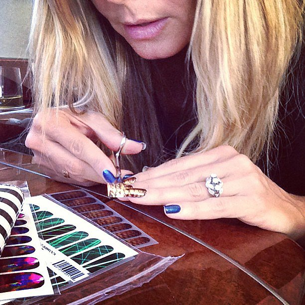 Some models might be too busy to do their own nails, but Heidi takes the time to apply long-lasting and colorful nail wraps. Check out her technique.  Source: Instagram user heidiklum