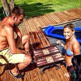 Bar Refaeli played a game of Backgammon while taking a dip in the pool. Source: Instagram user barrefaeli