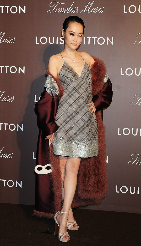 Rinko Kikuchi helped open Louis Vuitton's Timeless Muses exhibition in the label's plaid cocktail dress.