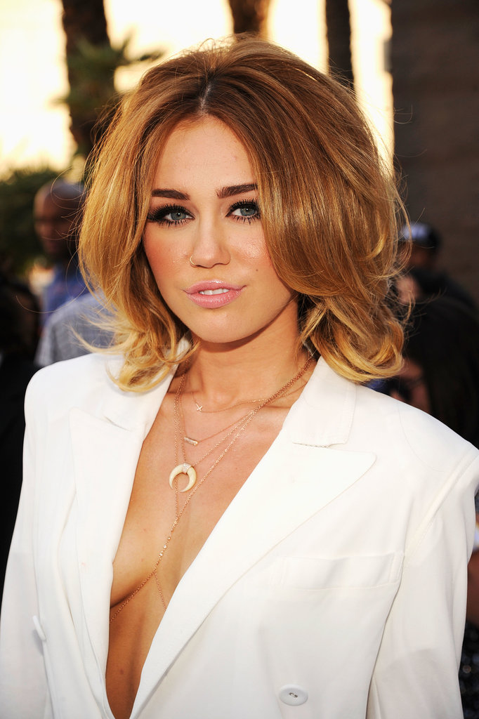 "With her voluminous curls, smoky eye makeup, and plunging neckline, Miley seemed to be sending a message at the 2012 Billboard Music Awards: ""So long, Hannah Montana!"""