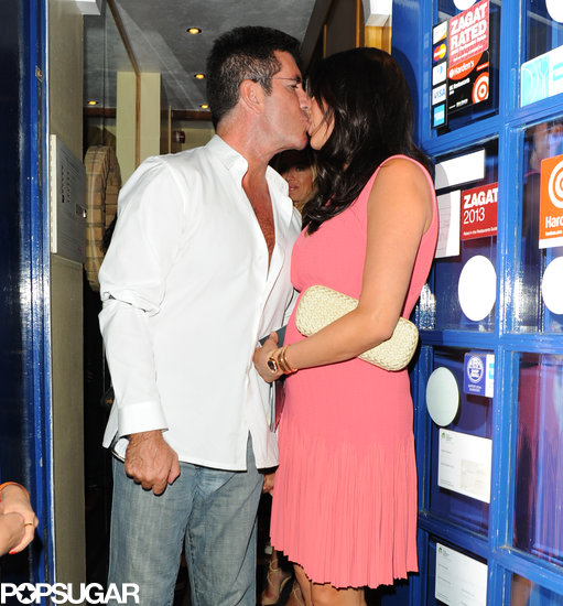 Simon Cowell kissed his pregnant girlfriend, Lauren Silverman.