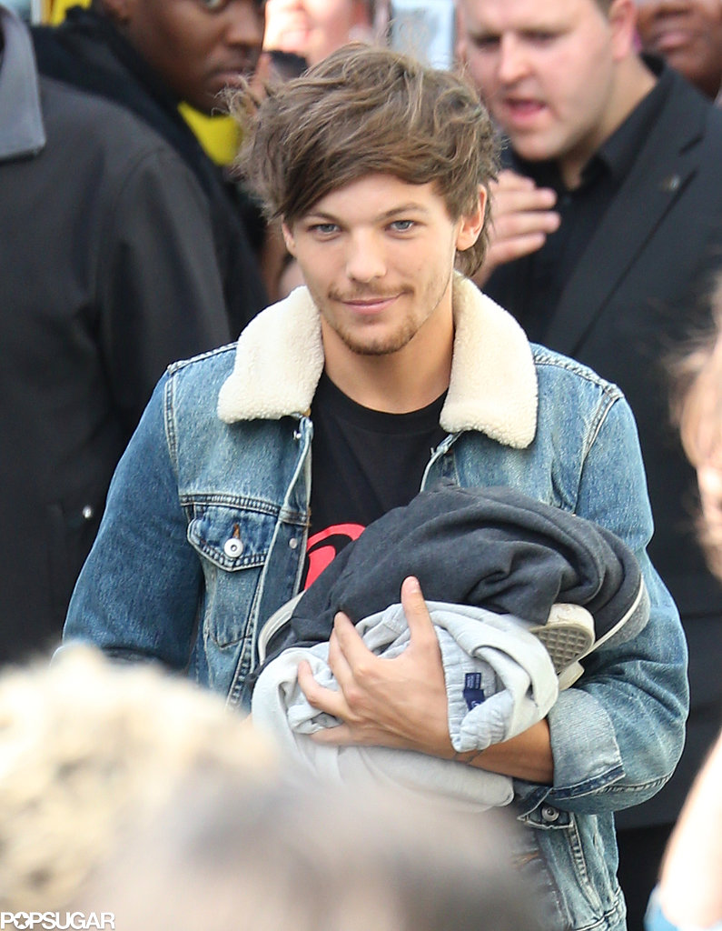 Louis Tomlinson smiled for the camera in London.