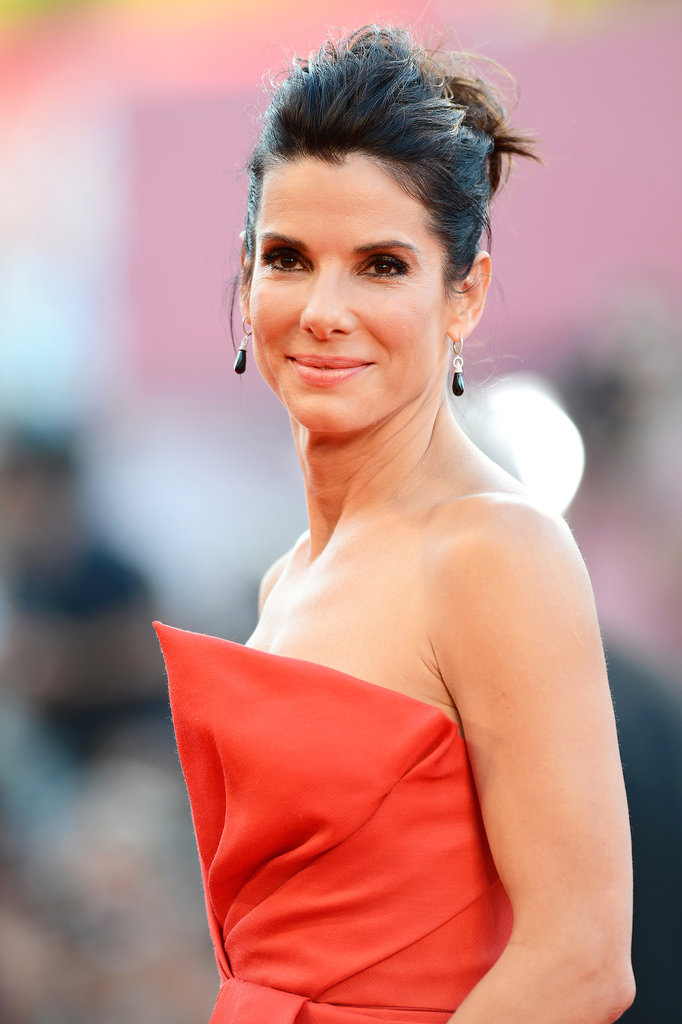 For the Gravity premiere, Sandra opted for a teased up 'do with a classic smoky eye.