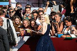 Dakota Fanning signed autographs for fans at the Venice Film Festival.