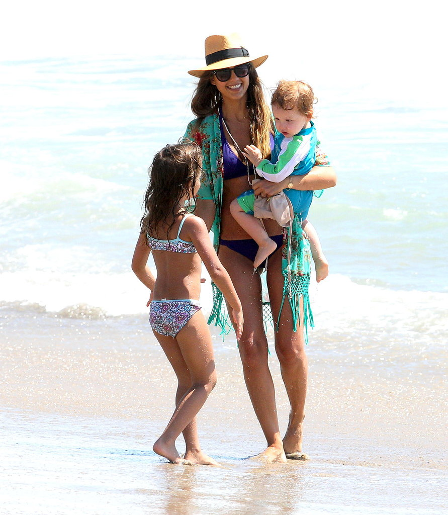Clad in a bikini, Jessica Alba carried little Haven on the beach.