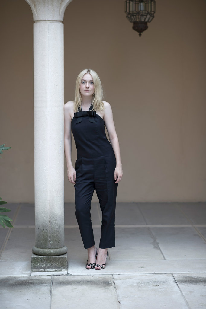 Dakota Fanning was spotted in a black jumpsuit from Viktor & Rolf's Resort 2014 collection at the festival.