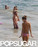 Alessandra Ambrosio hit the waves with her husband and daughter.
