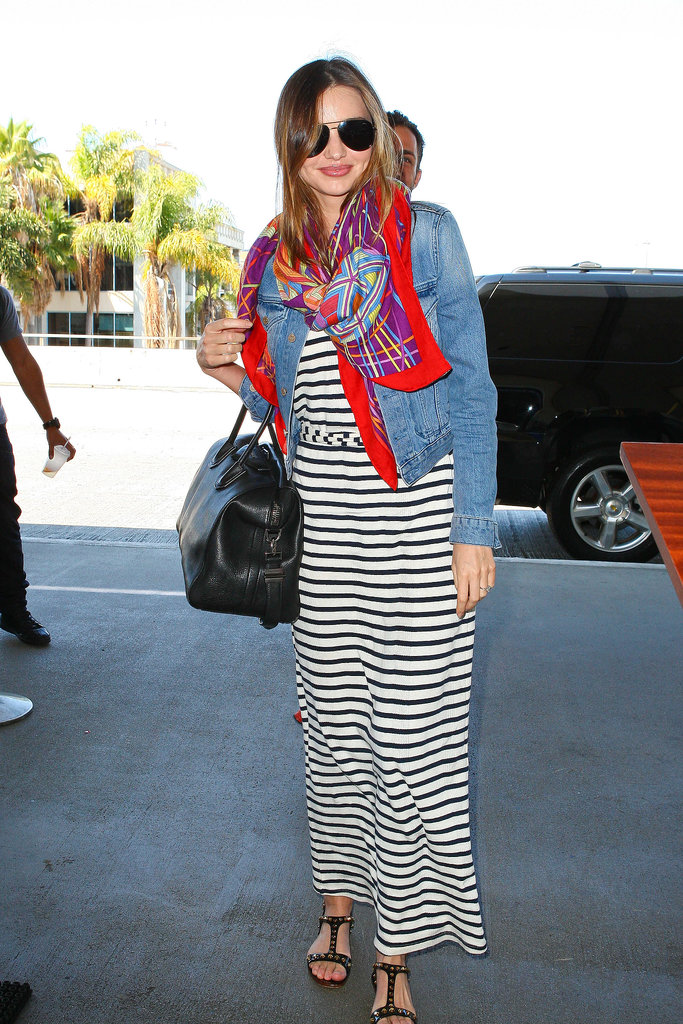 Miranda Kerr gives a lesson in airport dressing, throwing a denim jacket over a simple striped maxi while departing LAX.