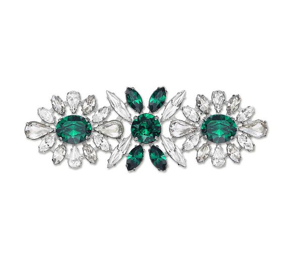 As the ultimate ladylike outfit accent, an emerald and crystal brooch ($150) is a finishing touch for any cardigan (or jean jacket).