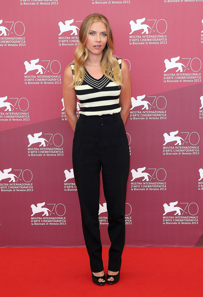 Scarlett Johansson rocked high-waisted Roland Mouret trousers with a black-and-white striped Sonia Rykiel top and Roger Vivier peep-toe pumps at the Under the Skin photocall during the Venice Film Festival.