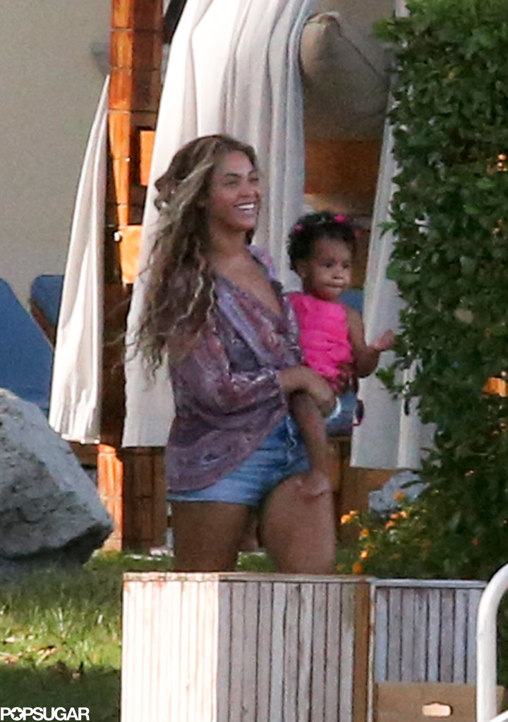 Beyoncé carried Blue Carter as they spent time by the pool with family during a vacation in Miami in July 2013.