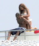 Beyoncé Knowles helped Jay Z with his sunscreen during a June 2005 afternoon near St. Tropez.